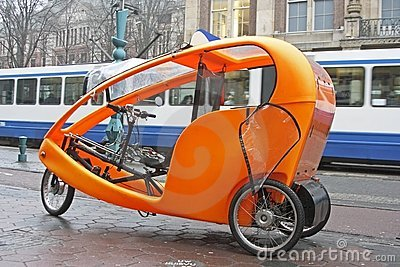 Orange bike taxi in Holland