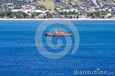 Orange Boat in Blue Water