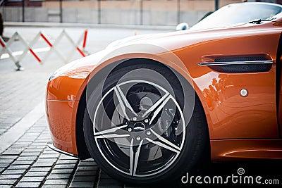 Orange Car Parked Near Grey Triangular Sign During Daytime Free Public Domain Cc0 Image