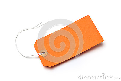 Orange cardboard or paper luggage tag isolated on white