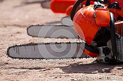 Orange chainsaw stands