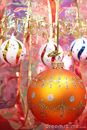 Orange christmas sphere and celebratory ribbon 2