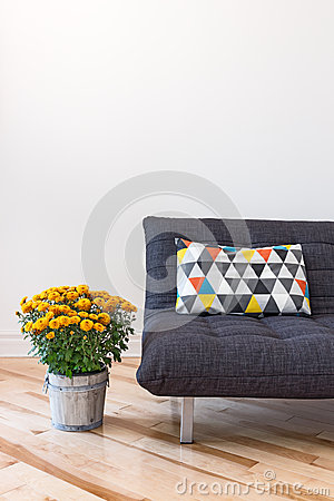 Free Orange Chrysanthemums And Sofa With Bright Cushion Royalty Free Stock Photography - 33951747