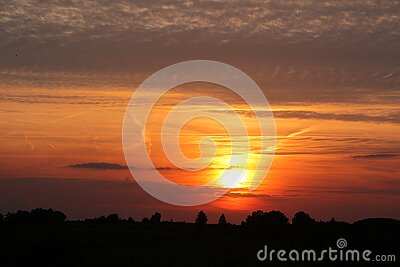 Orange Cloudy Sunset Over Tree Silhouettes Free Public Domain Cc0 Image