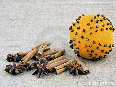 Orange with cloves on linen background