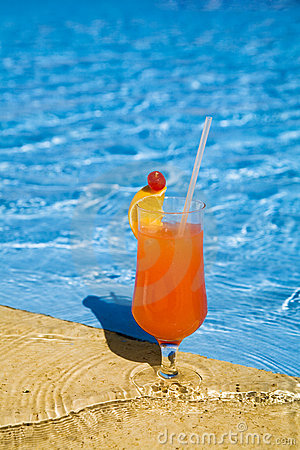 Free Orange Cocktail Stands On Edge Of Pool. Stock Image - 1691441