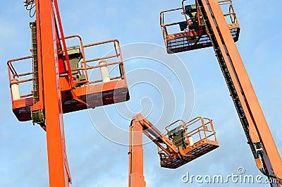 Orange construction crane baskets