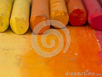 Orange crayons background