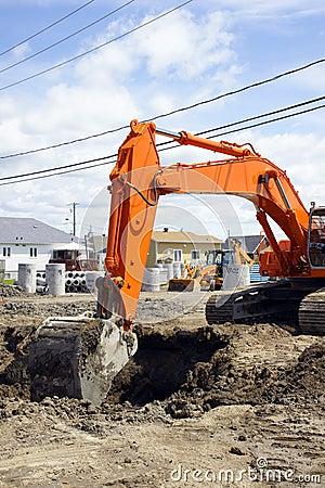 Orange digger and deep hole