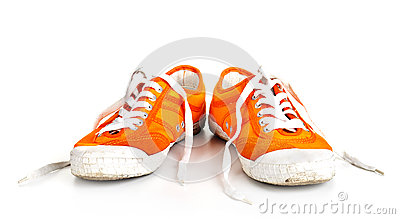 Orange dirty shoes isolated