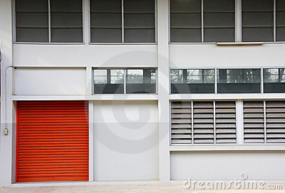 Orange door on the white wall