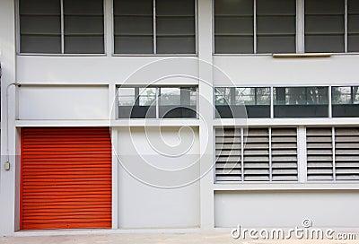 Orange door on the white wall