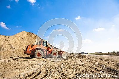 Orange excavator on a construction site