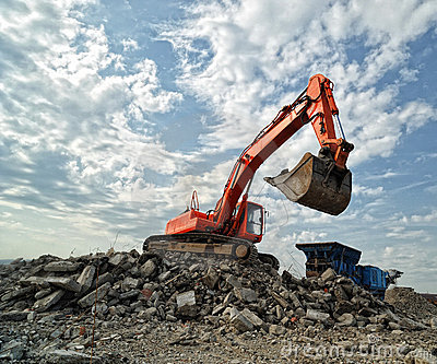 Orange Excavator on construction site