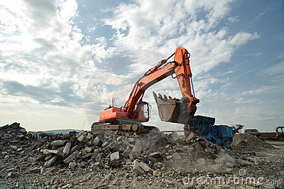 Orange excavator excavating on site