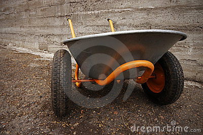 Orange farmer s two wheelbarrow
