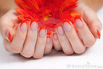 Orange fingernails and bright flower
