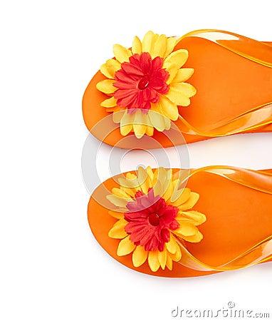 Orange flip-flops with flowers