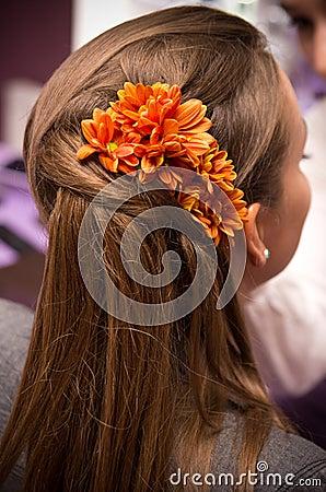 Orange flowers in hair
