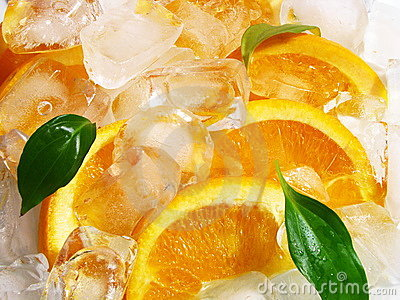 Orange fruits with ice cubes
