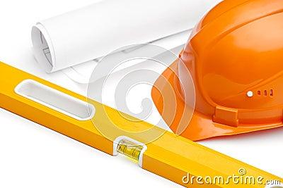Orange hard hat, druft and level