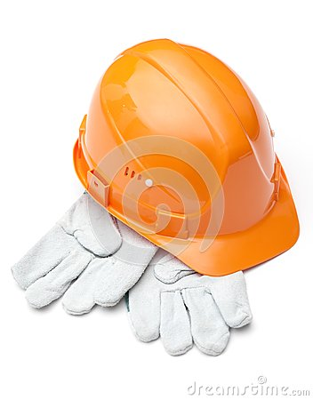 Orange hard hat on white gloves