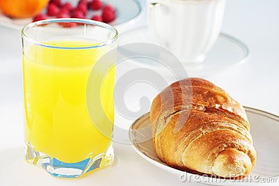 Orange juice and croissant