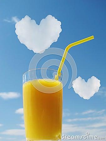 Orange juice in glass. Hearts in a sky