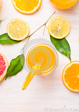 Free Orange Juice Glass With  Slices Of Citrus And Green Leaves On White Wooden Royalty Free Stock Images - 47690289