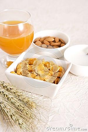 Orange juice, milk with corn flakes