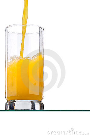 Orange juice poured into a tall glass