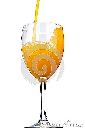 Orange juice poured into a wine glass