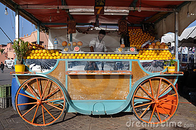 Orange juice seller in Marrakesh Editorial Photo
