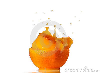 Orange juice splash inside an half orange isolated