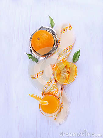 Free Orange Juice, Squeezed Fruit And Stainless Steel Citrus Juicer On Blue Woden Stock Image - 48188261