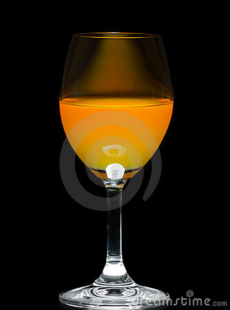 Orange juice in wine glass