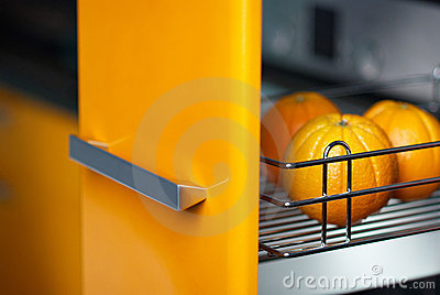 Orange in kitchen in fridge