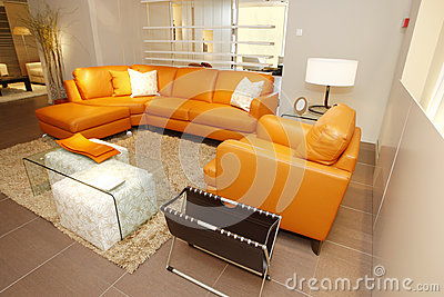 Orange leather couch and armchair set in furniture