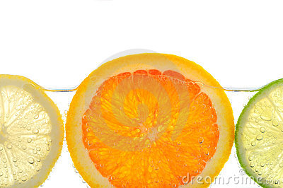Orange lemon and lime slices in water