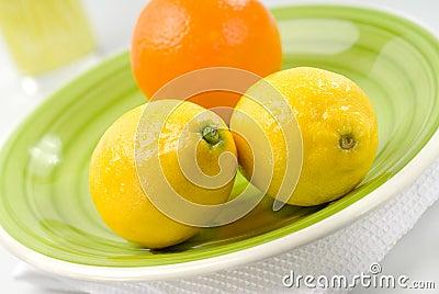 Orange and Lemons on Green Plate