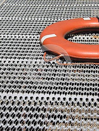 Orange Life Ring on Grating