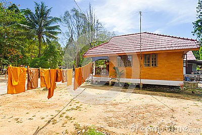 Orange monk clothes drying on the sun