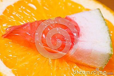 Orange and piece of grapefruit.