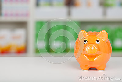 Orange piggy bank on pharmacy counter