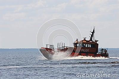 Orange pilot boat