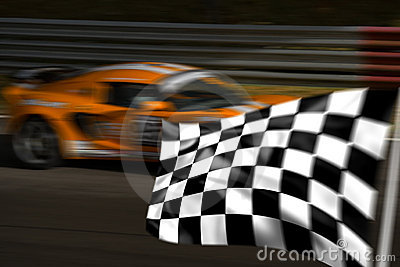 Orange racing car and chequered flag