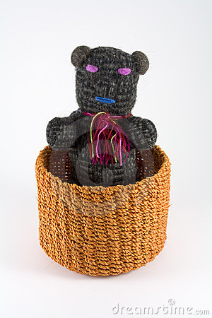 Orange rattan basket with puppet