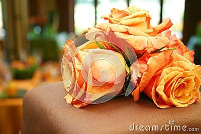 Orange roses on chocolate cake 051