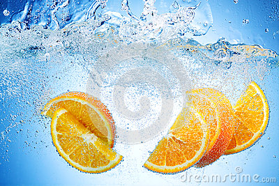 Orange Slices falling deeply under water with splash