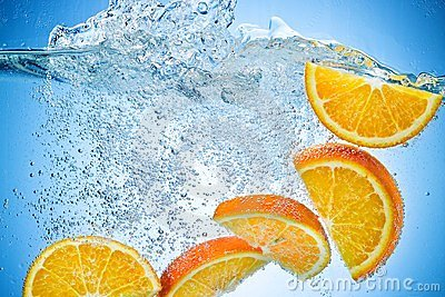 Orange Slices falling under water with splash